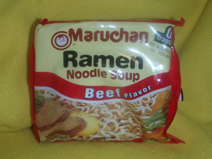 A plastic package of instant ramen noodles, beef flavor