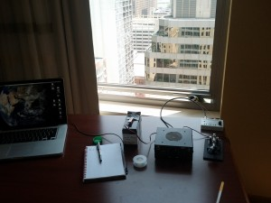A view out the window of the Marriott Courtyard downtown hotel. In the foreground: a tentec 1320, straight key, and Hendricks SLT+ longwire tuner