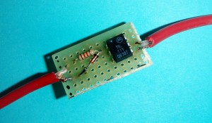 A close-up image of the optoisolator, diode and resistor interface