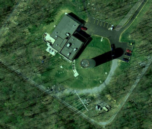 An aerial shot fo two log periodic antennas within the compound