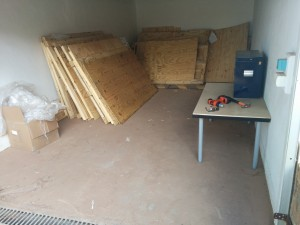 This is after clean-up; initially, the wood was jumbled in a big pile and the blue tool box was hidden underneath in a corner.