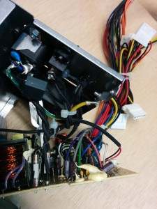 The original fuse (white tube) after cutting away black heats hrink tubing.