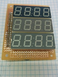 Three 4-digit displays: red, yellow, and green.