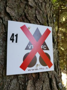 "french cycling federation metal sign with a big red ""x"" through it"