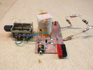 Photo of earlier version with air variable capacitor and a 47k resistor serving as dummy load.